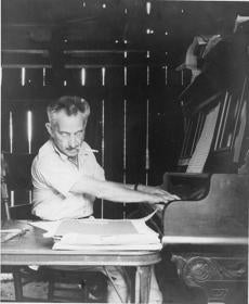 In a photo from around 1935, Weiner composes at his piano in the Catskills, where he went in summer. His Yiddish art songs flowered in the mid-20th century.